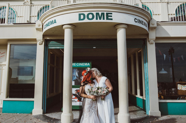 Couple kissing Outside Worthing Wedding Venue