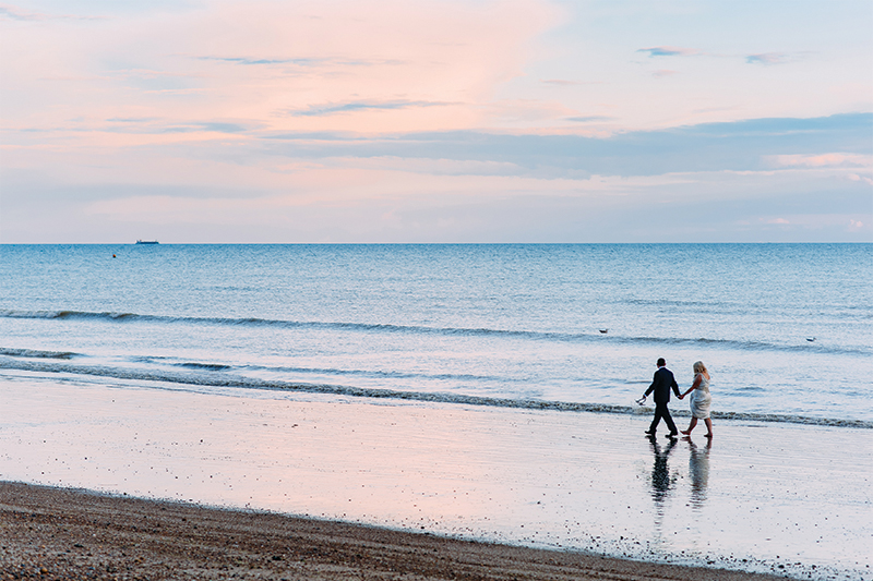 Couples Wedding Portrait On Worthing Beach